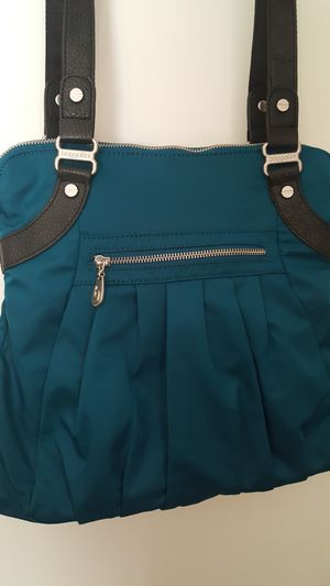 Teal water proof purse. for Sale in Edgewood, WA