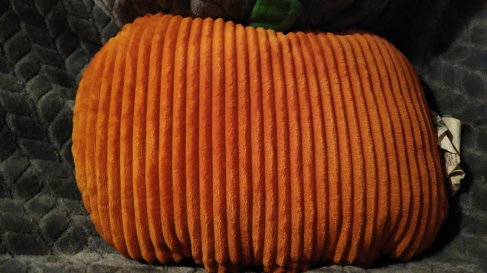 Stuffed smiling pumpkin pillow