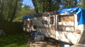 Photo Camper travel trailer 1970's 28 ft. No title will give bill of sale