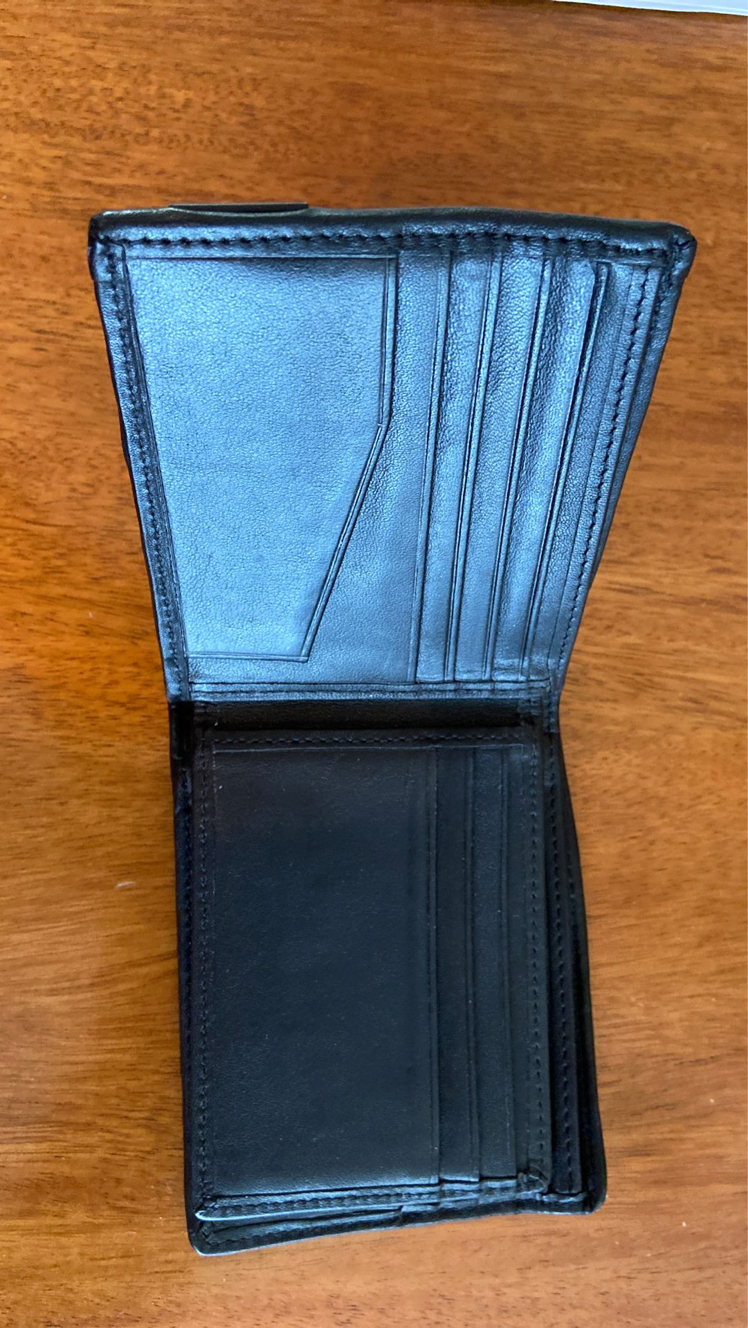 Tumi wallet bi fold with space for 14 cards and ID