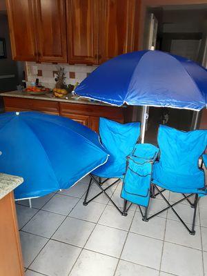 Photo 2 beach chairs, 2 umbrella