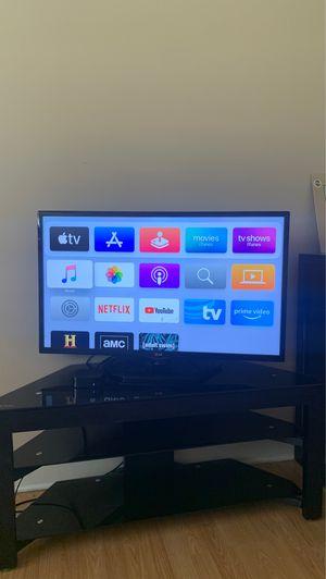 "Photo 35"" LG TV + 3 Tier Glass TV Stand + Apple TV (4th Gen)"
