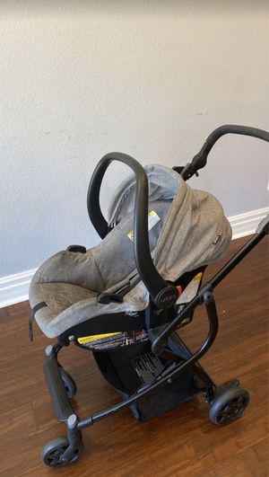 Photo Urbini 3 in 1 stroller and baskinet with car seat and base