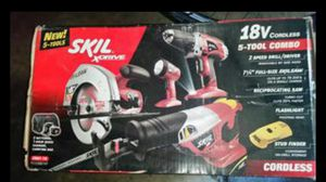Photo New (never opened) Skil 5 piece 18.0 Volt Tool Kit.