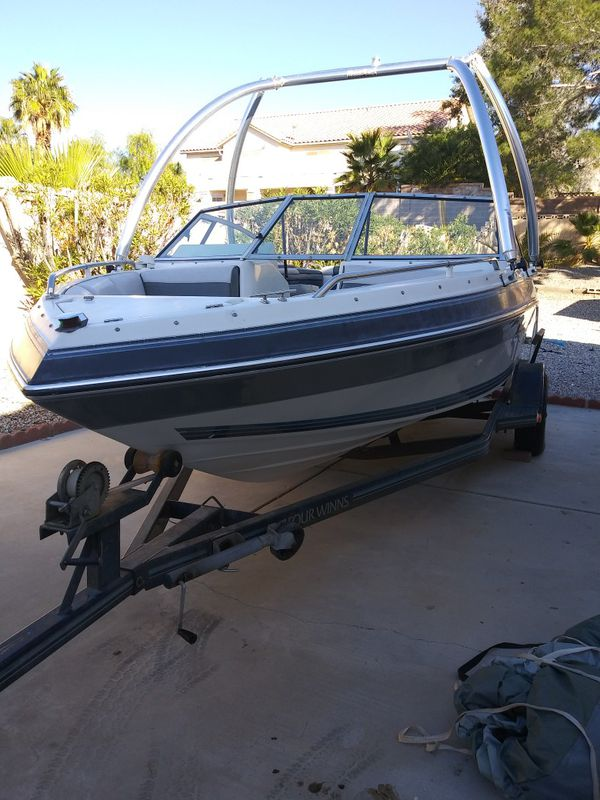 1990 4 winns boat& trailer with extras!