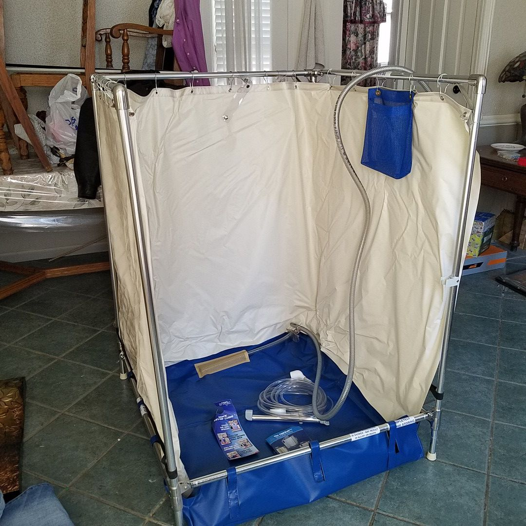 Fawsit portable shower top of the line like new. $999 firm no PVC strong lightweight metal strong pump.