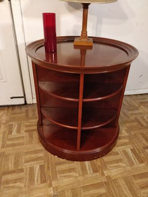 """Nice wooden round table with 8 shelves and 2 cabinets in very good condition, pet free smoke free. Diameter p25""""*H25"""" for Sale in Annandale, VA"""