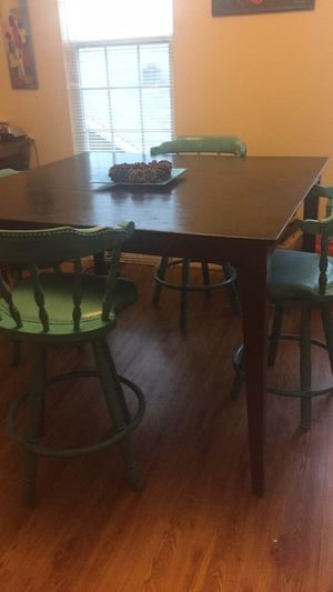 Painted brown dining room table with 4 blue bar height chairs for Sale in Elkridge, MD