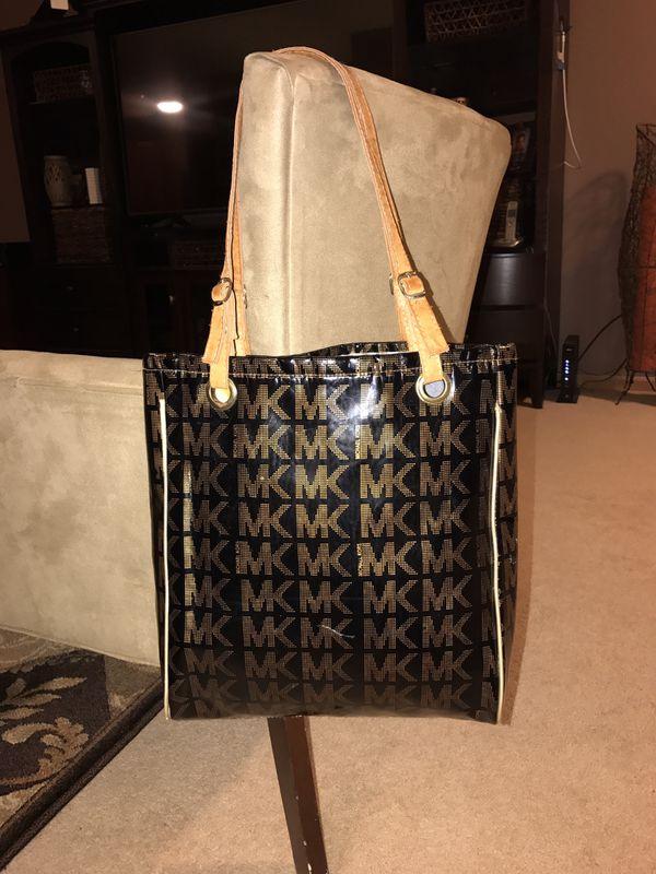 f6ec368cfd2b04 Shiny black & gold Michael Kors Tote bag for Sale in Saint Paul, MN ...