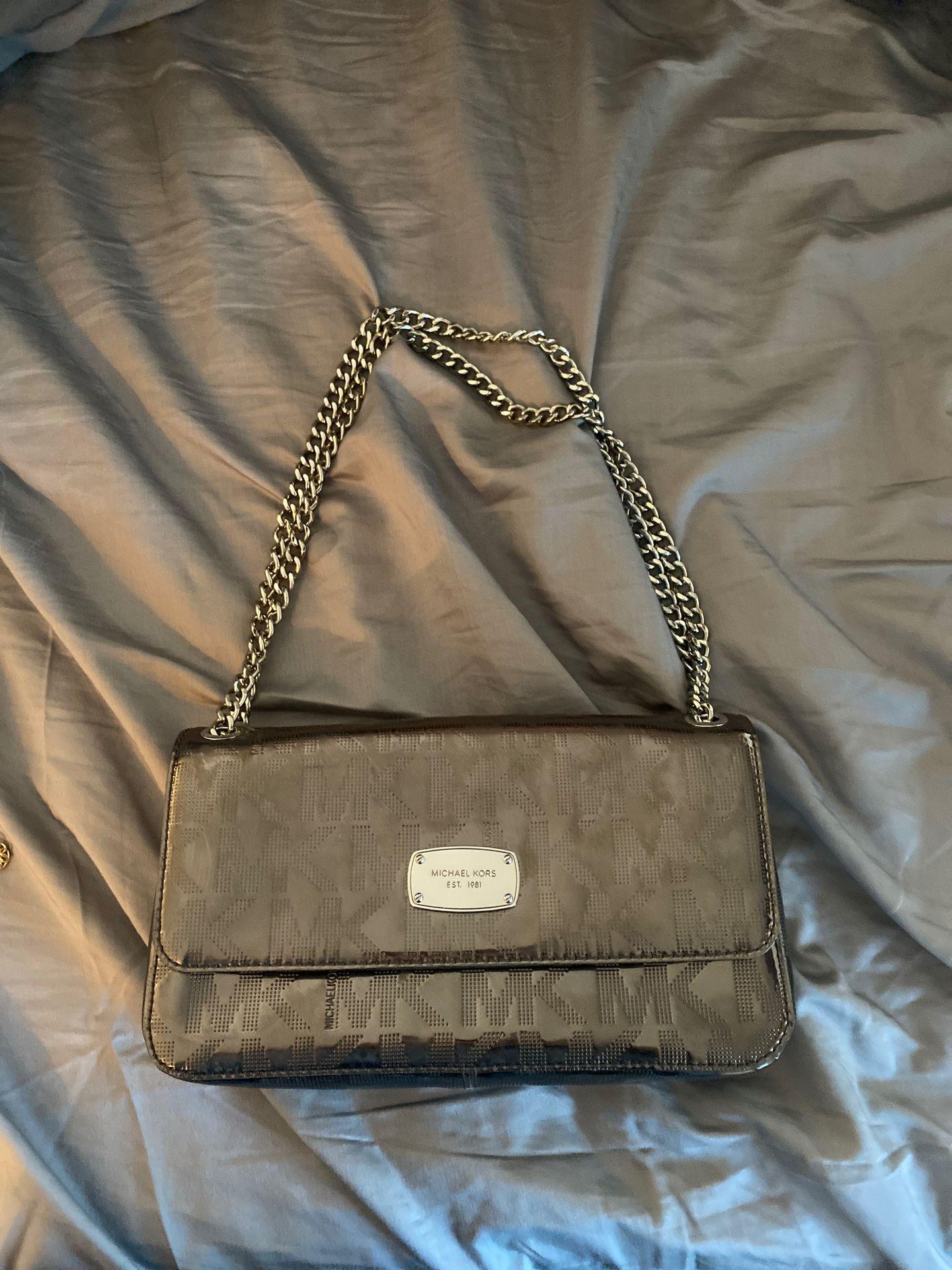 Beautiful Michael Kors silver handbag