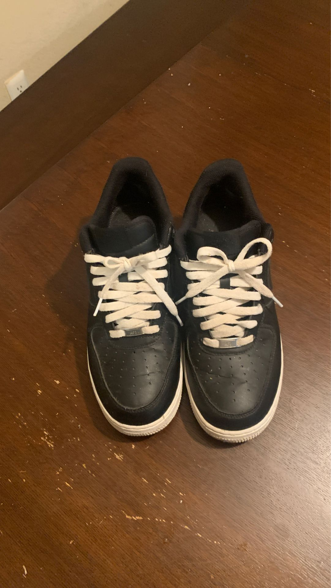 White and black airforce ones