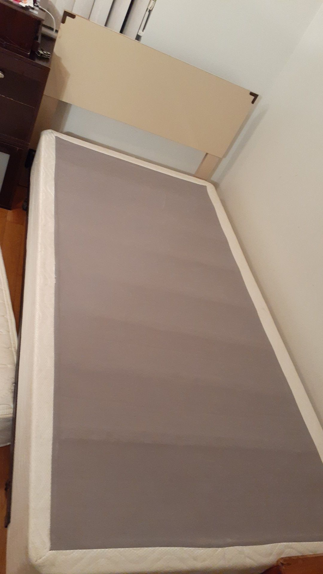 Bed with mattress and metal wheels