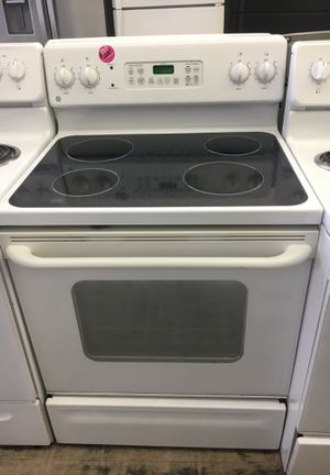 GE white glass smooth top electric stove for Sale in Cleveland, OH