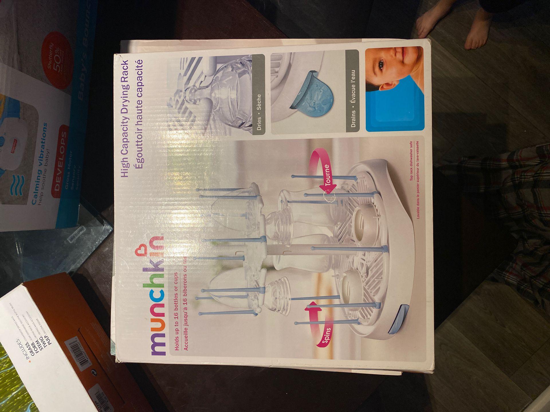 Baby bouncer/bather/sterilizer/drying racks