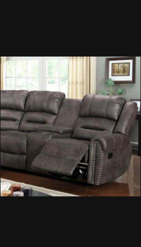 Kenedy Brown reclining Sectional Sofa