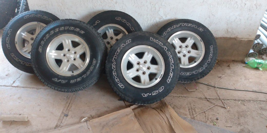 5 Stock Jeep 15-in Rims And Tires Wrangler Tires Used In Good Condition