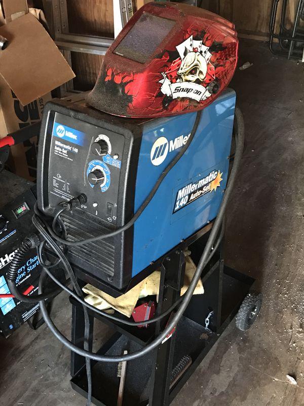 Millermatic 140 mig welder with snap on auto darkening mask. Cart ...