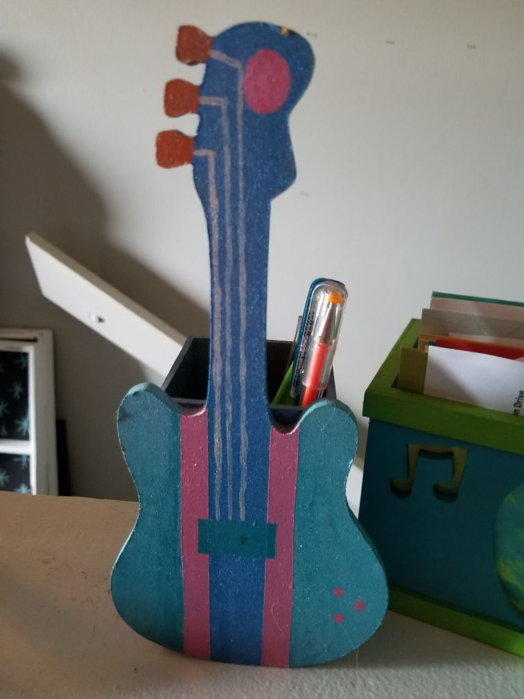 Guitar pencil and letter holder