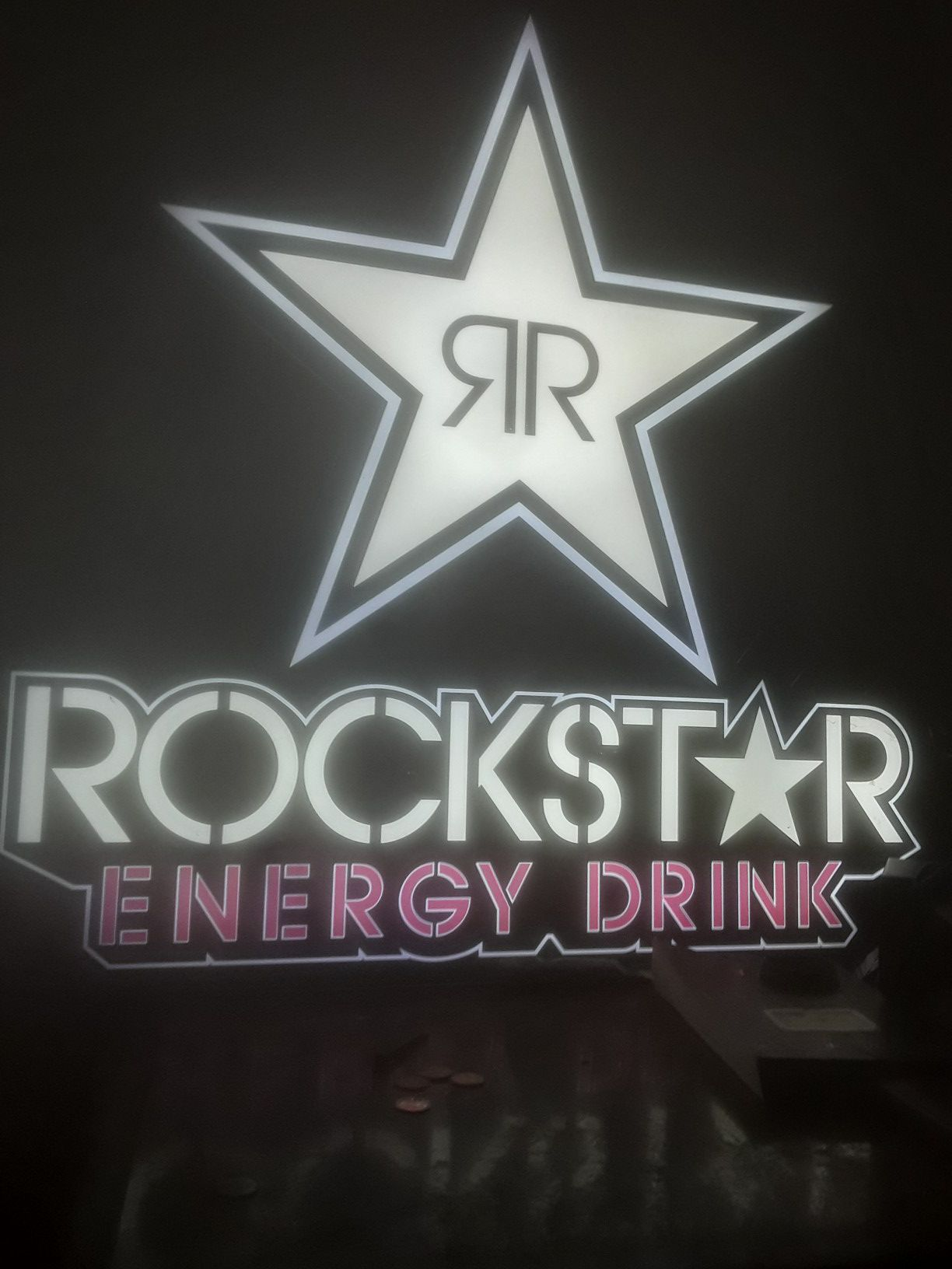 Rockstar energy light works perfect great for bedroom garage or man cave no cracks its perfect