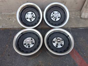 Photo Set of four Chevy C10 Rally rims, center caps, and beauty rings. 15 in
