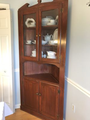 Cherry finished corner cabinet for Sale in Harpers Ferry, WV