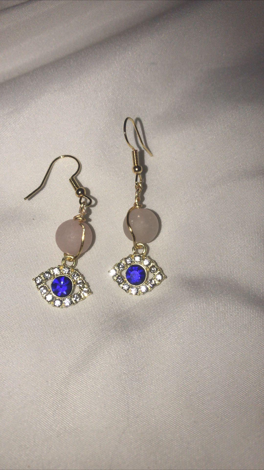 Rose quartz and eye pendant earrings