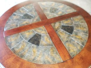 Slate accents round dining table with 4 cushion bottom metal chairs for Sale in Lynchburg, VA