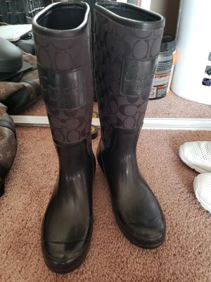All black rubber waterproof signature coach rain boots size 8 womens for Sale in Desert Hot Springs, CA