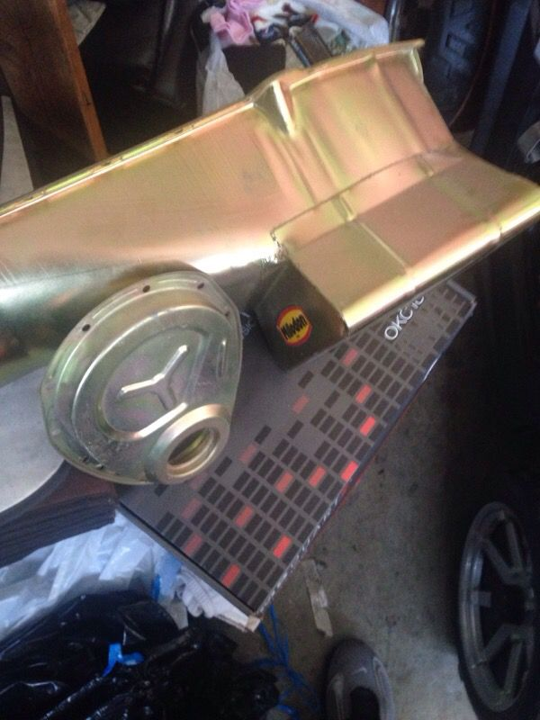 Brand-new Milodon 7 qt oil pan an timing chain cover zinc plated gold for  Sale in San Mateo, CA - OfferUp