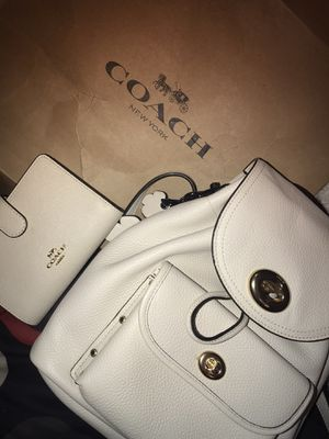 Photo Coach leather backpack and wallet