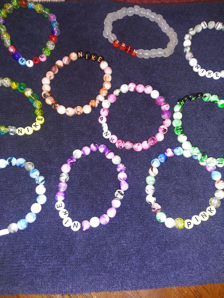 Nike. Pink. Bracelets