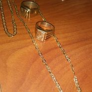 2 18k italian ring solid gold and a nekless wid the bracelet italian 14k