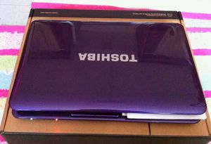 Purple Toshiba laptop what's web camera upgraded to Windows 10 HD screen DVD burner for Sale in Grove City, OH