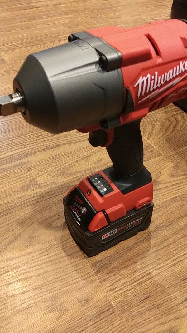 Milwaukee Half Inch Impact Wrench With A 5 0 Battery