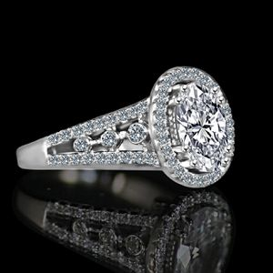 Radiant Oval 2.5 CT. Split Shank Floating Halo with tiny round sides Simulated Diamond - Diamond Veneer Sterling Silver Engagement/ Wedding Ring. for Sale in New York, NY
