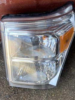 2011-2016 Ford F-250, F-350, F-450 Left Headlight OEM Thumbnail