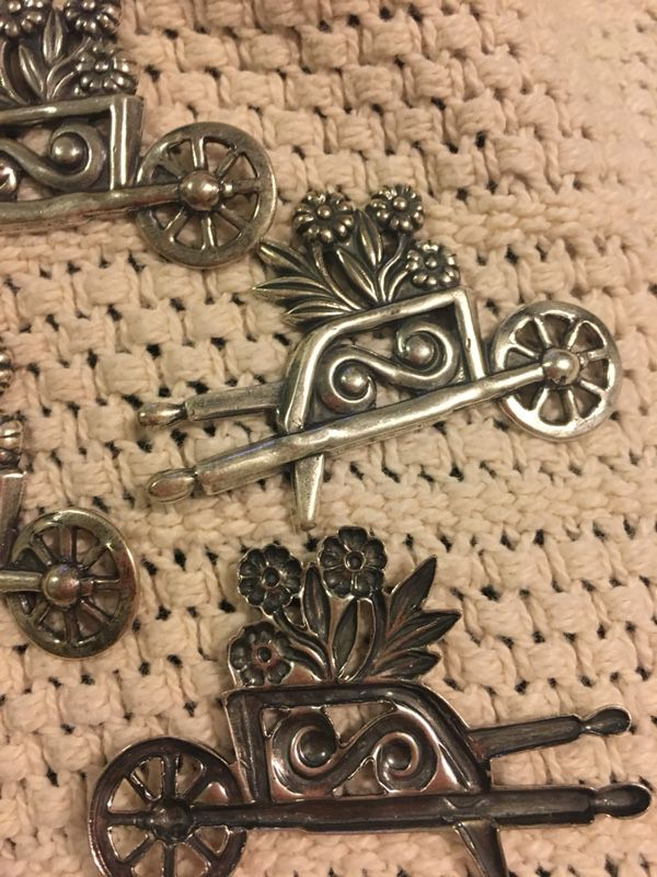 Metal wheelbarrow with flowers , arts and craft , pins , put on the fridge with a magnet . $2.50each . Great for Mother's Day