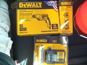 Photo DeWalt keyless Chuck drill kit. DeWalt 20 volt lithium ion drywall cut out tool . DeWalt 20v battery and charger