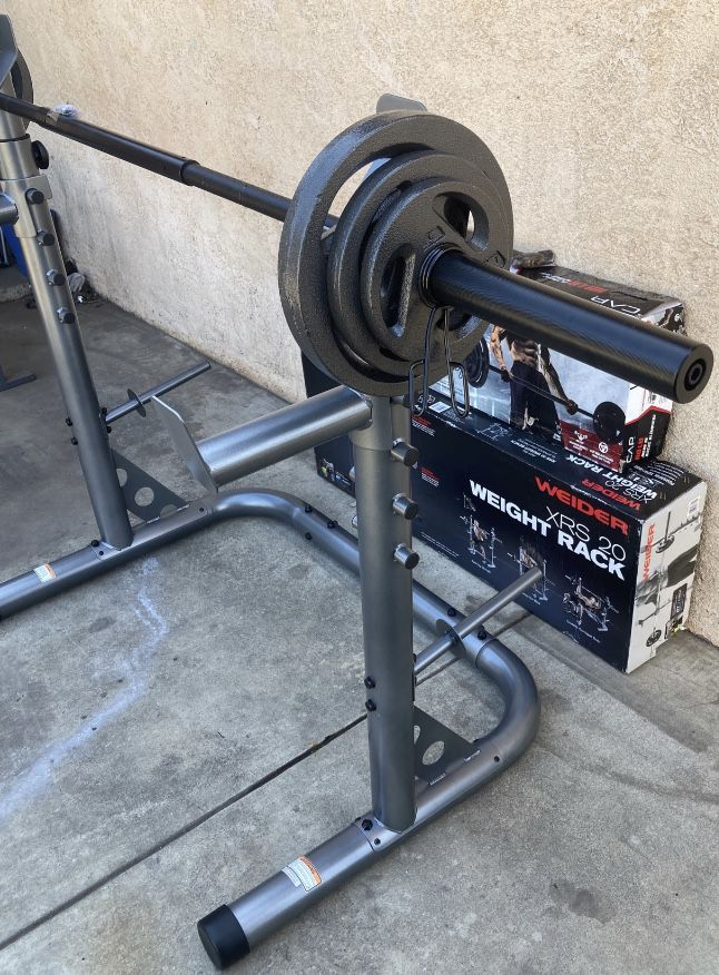 Weights XRS 20 Squat Rack With 110lb Olympic Set Comes With a 3 Piece 7ft Olympic Bar 2x25s,2x10s and 2x5s (built or in Box)