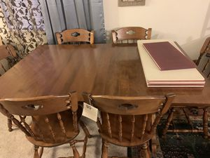 Photo Real wood dining. Table with 6 matching chairs and table pad and 3 extension made for ( S. Bent & Bros ) Brand new has tag. 64 x 42 x 30 inch