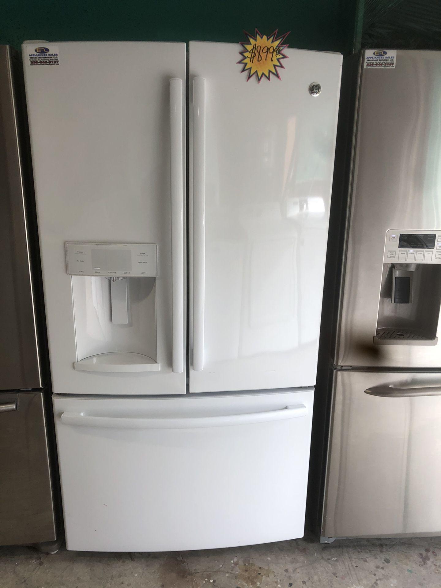 A white three door Ge refrigerator