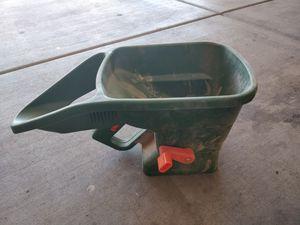 Photo Grass seed and fertilizer spreader