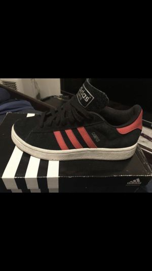 Adidas tennis shoes size 5 1/2 youth in like new condition color black with red stripes for Sale in Washington, DC