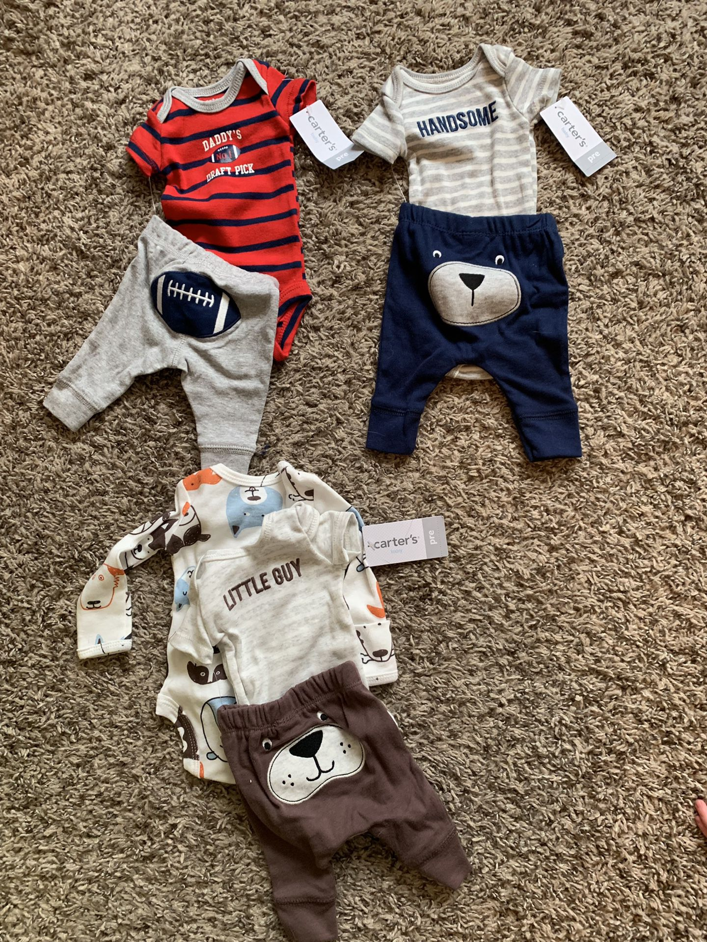 Premi baby outfits tags still on!