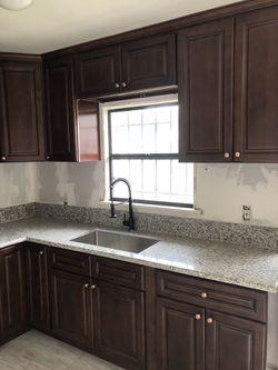 Cabinets, granite and quartz Thumbnail