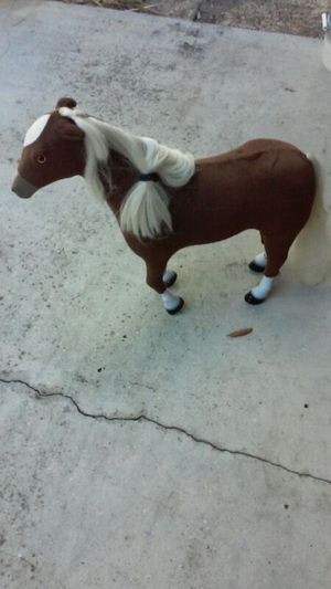 Velour horse that legs bend uses batteries for Sale in Kissimmee, FL