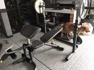Photo Weight bench with leg feature and weights
