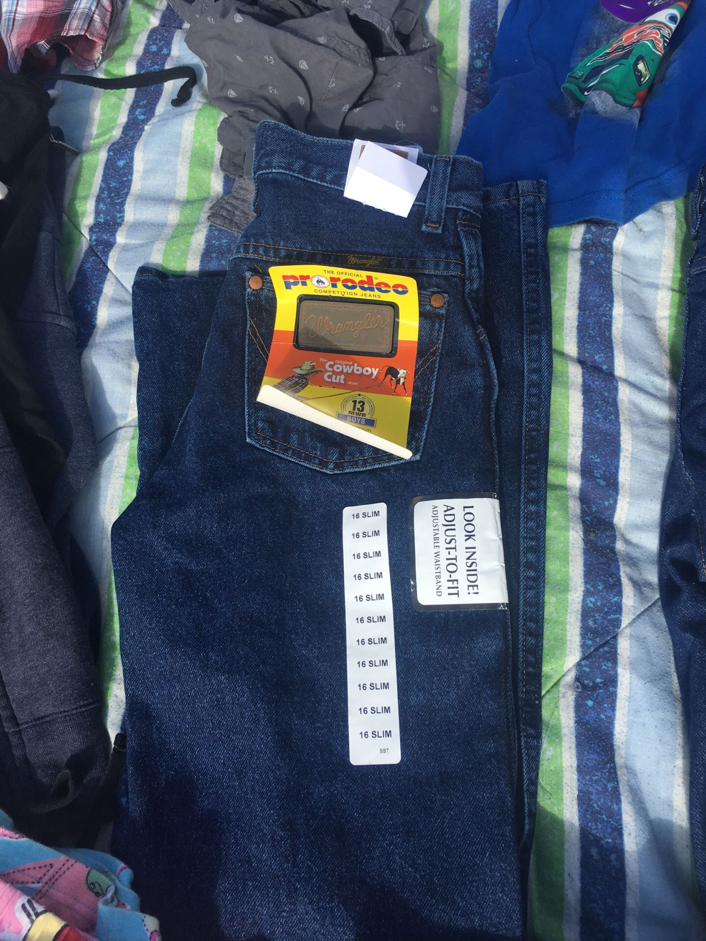 Wrangler pants size 16 slim and 14 regular 2 for $40
