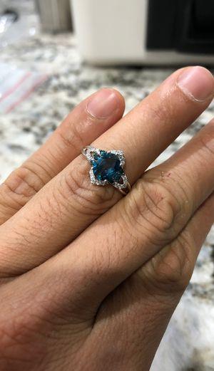 Photo 14kt White gold blue/white diamond and light blue topaz ring