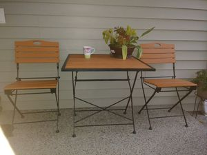 Photo Folding Patio table with two chirs